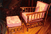 stick furniture chair with yellow toile and red checked cushions