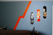 boys room with skateboard theme where orange is that pop of color.
