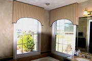 bathroom windows with tan cornices piped in black with motorized shades.