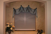 Blue silk window treatment in bathroom with motorized shade