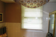 Floral bathroom window treatment with wood blind