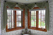 Sage green scarf window treatment  in bathroom with pleated shades