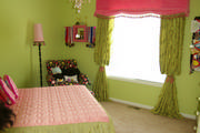 girls pink and green window treatment with trim and tassels
