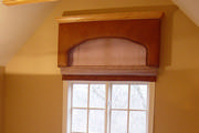 ostrich skin leather cornice with crown molding and roman shade on window