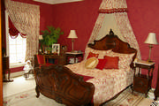 Queen Ann bed with Corona and tailored bedspread in red and cream toile including pillows