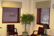 Leaf fabric covered cornices over wood blinds help with sun control in this waiting room.