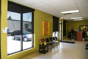 Veterinary office windows need a roller shade to keep out the sun and yet easy to clean. Solar mesh is the answer.
