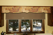 Shaped cornice over a kitchen sink take the place of the old wood apron between the upper cabinets.