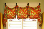 This colorful palm tree and monkey themed toile valance give a touch of whimsy to this laundry room window