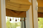 Close up of the roman shades show a beautiful banding with trim from Robert Allen