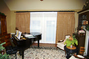 Embroidered Faux Silk draw drapes over sheers give this music room just the right amount of privacy.