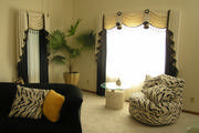 Beautiful cream and black drapes, swags, cascades and sheers are exactly what this client wanted for her living room.