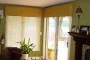 Bowed faux ostrich skin cornices for corner windows gives an architectural element to the room.